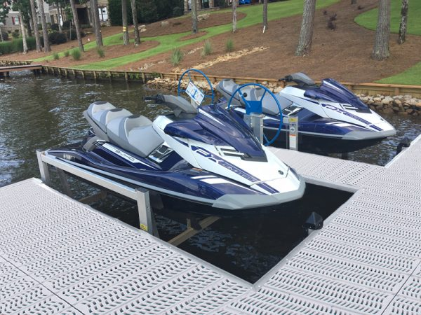 two jet skis on a pwc lift off a dock