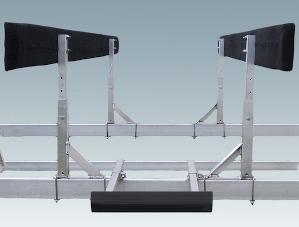 padded black brackets attached to metal boat lift frame
