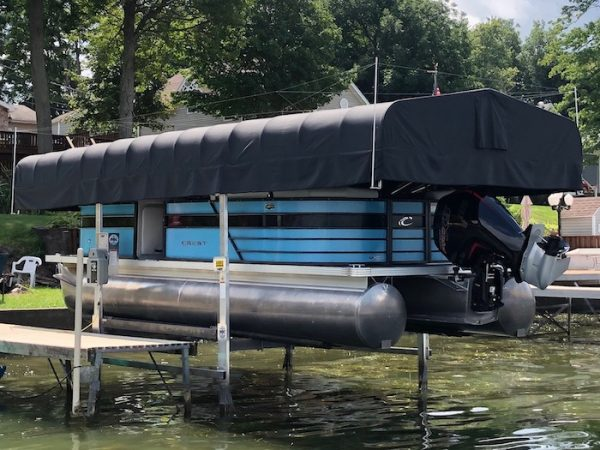 boat lift canopy with upward facing rods to discourage birds