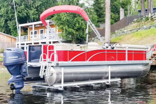 hydraulic lift with red pontoon boat
