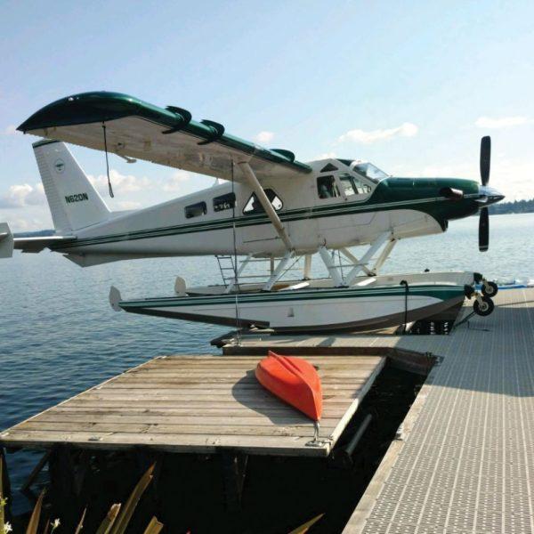 RGC seaplane lift with green & white seaplane